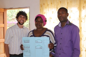 Shawn, Lettie, and Bonginkosi with the plans for Vikelani Abantwana