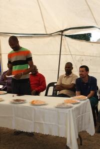 Leave MC's in front of Bonginkosi, Uncle Arthur, Dumisani, and Erik