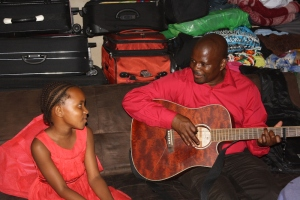 Uncle Arthur playing his new guitar, Lando sings along